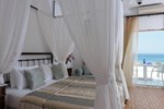 Отель Mykonos Palace Beach Hotel