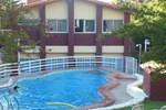 Отель Hotel Aoma Villa Carlos Paz