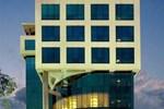 Отель The Muthoot Plaza