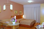 Отель Harbor Regent Suites