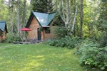 Отель Across the Creek Cabins