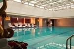 Отель Huaqiao New Century Grand Hotel Lishui