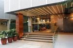 Отель Guijo Suites Makati