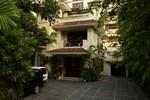 Отель Orchid Garden Suites