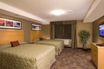 Отель Woodlands Inn & Suites