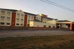 Отель Magnolia Bay Hotel & Suites