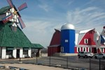 Отель Windmill Inn & Suites