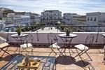 Апартаменты Apartamentos La Casa de la Alameda