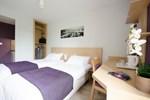 Отель Comfort Suites Lyon Est Eurexpo