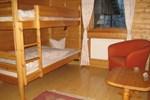 Отель Snowtrail Dogcamp Lodge