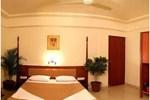 Отель Saffron Suites