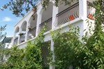 Апартаменты Olive Garden Apartments