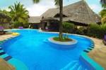 Отель Mnarani Beach Cottages