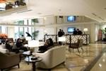 Отель Maxims Hotel