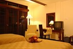 Отель Pines Garden Resort