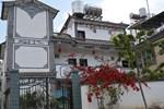 Отель Dali Jiu Shi Guang Lv Wo Inn