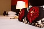 Отель Peacock Suites