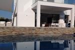 Вилла Serenity Sea Front Villa