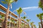 Palm Village Suites