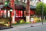 Отель Michelle's Suites