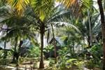 Отель Leela Cottages