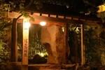 Отель Yufuin Besso Shikisai Hotel