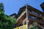Отель Longsheng Longji Traveler Guesthouse