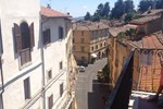 Апартаменты Attico con vista sui tetti