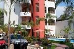 Апартаменты Hotel y Suites Los Encantos