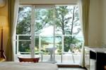 Отель AJ Onna Biru Resort Hotel