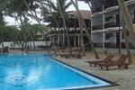 Отель Whispering Palms Hotel