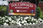 Отель Touchwood Motor Lodge