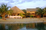 Отель Green Parrot Beach Houses and Resort