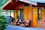 Отель Handsome Dan's Wild Coast Guest Cottages