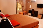 Отель Swiss Cottage Suites