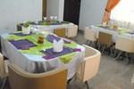 Отель Figlos Hotel And Suites