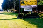 Отель The Whispering Pines Motel- Whitestone