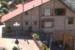 Отель Cabañas 5 Pinos
