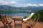 Апартаменты Attico Lago D'Orta