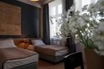 Отель Qbatura Cafe & Hotel
