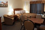 Отель Service Plus Inn and Suites Calgary