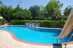 Апартаменты Villa Acacia con Piscina
