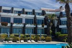 Отель Caloura Hotel Resort