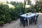 Апартаменты Villa Elegante Con Terrazzo E Giardino