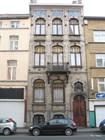 Брюссельское кружево на окнах домов
