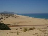Песчаный пляж Piscinas