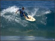 Серфинг на пляже Piscinas