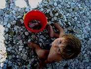 Галька на пляже Spiaggia di Sassonia