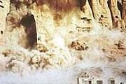 Подрыв статуй Будды. Фото: CNN
