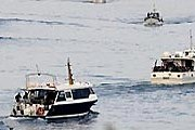 Рыбаки не пускают суда в порты. // AFP